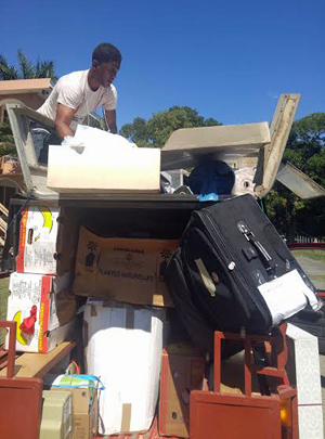 """Fancy"" is a really hard worker – here Caleb is loading up from the shipping container in Cap Haitien for the 6-7 hour drive south to Port-au-Prince."